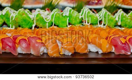 Japanese Cuisine -buffet Catering Style Sushi Set In Restaurant - Salmon Maki Sushi And Nigiri Sushi