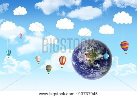 Earth against hot air balloons hanging from clouds