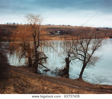 Rural Landscape With Frozen River