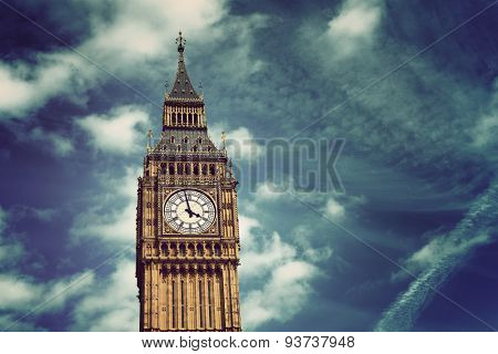 Elizabeth or Clock Tower of Westminster Palace, landmark and tourist attraction known as Big Ben, in London, UK, under a cloudy dramatic sky