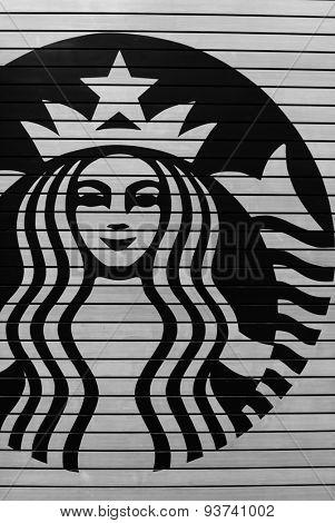 KUALA LUMPUR, MALAYSIA - MAY 06, 2014: Starbucks Cafe logo. Starbucks Corporation is an American global coffee company and coffeehouse chain based in Seattle, Washington