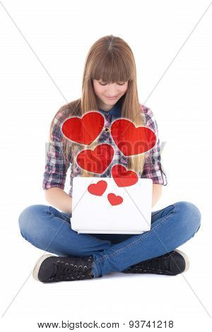 Cute Teenage Girl Sitting And Sending Love Messages With Laptop Isolated On White