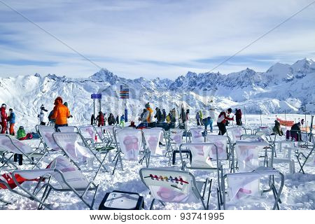 In the foreground there are chairs from the nearby ski restaunt