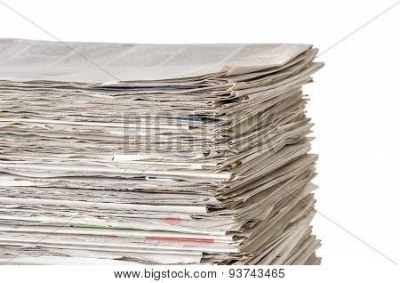 Piled Newspapers On A White Background