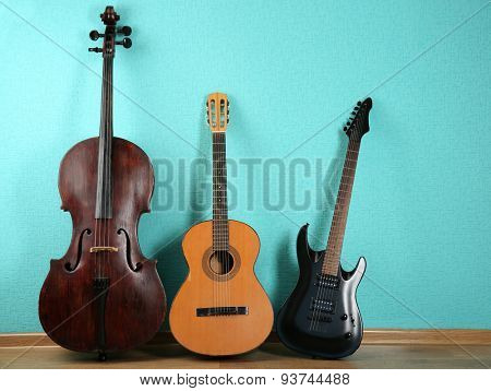 Musical instruments on turquoise wallpaper background