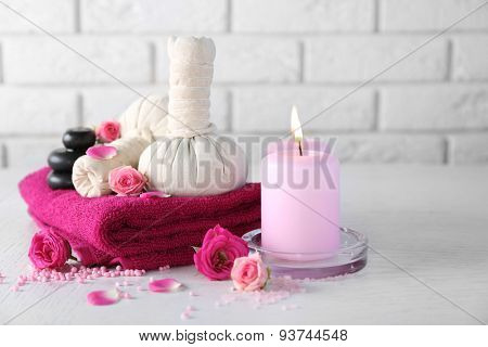Beautiful composition of spa treatment on white wooden table