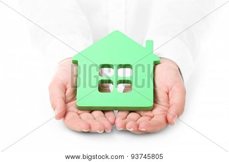 Female hands holding house, closeup