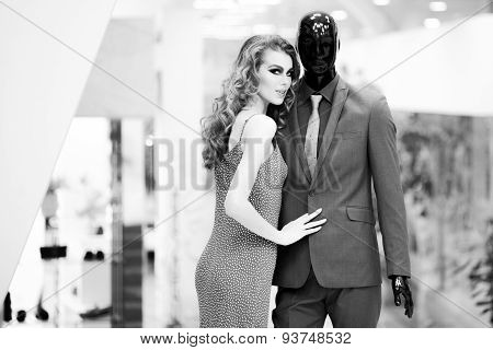 Enigmatic Girl And Mannequin