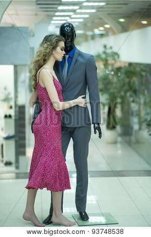 Tempting Girl And Mannequin