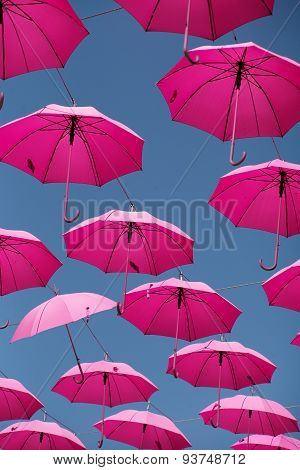 Pink Parasols In The Air