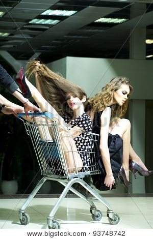 Two Girls With Shopping Trolley