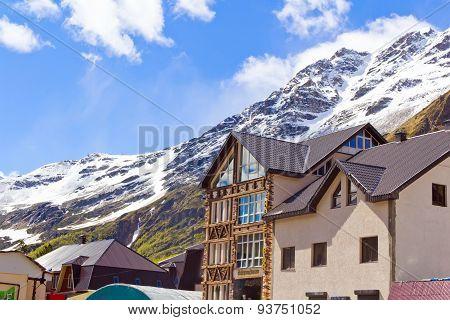 Caucasus Rockies And Houses