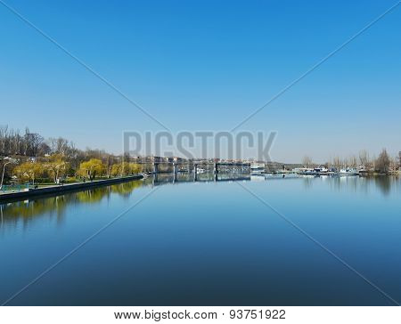 blue sky over river with bridge