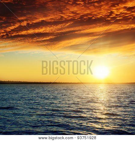 good red sunset over darken water