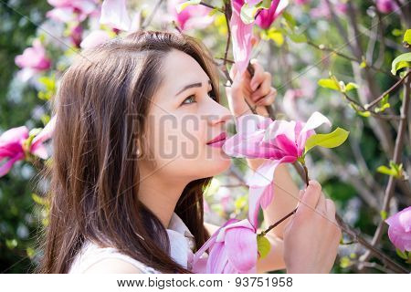 Dreamy Girl Holding A Branch Of The Magnolia