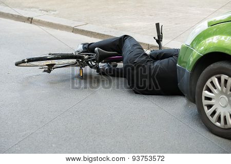 Male Cyclist After Car Accident On Road