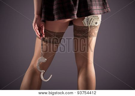 Stockinged Legs With Handcuffs And Dollars