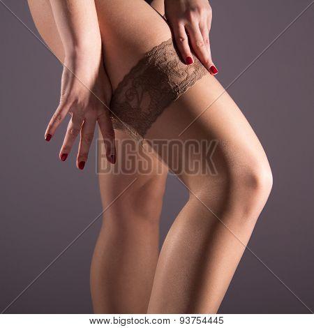 The Woman Wears A Nylon Stocking On Slender Leg