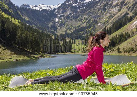 Woman Doing Upward Facing Dog Outdoors