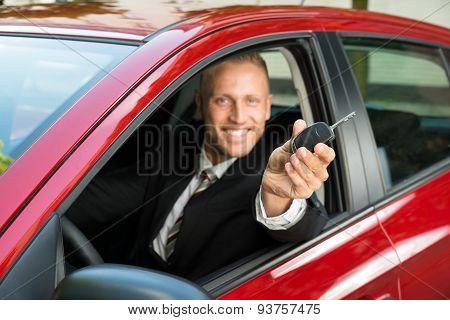 Businessman Showing New Car Key