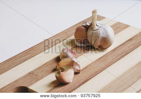 Raw garlic on the cutting board