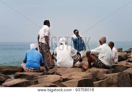 Fishermen Are Resting After Work On Samudra Beach In Kovalam