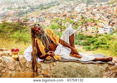 Indian man resting on the wall
