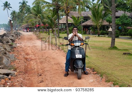 Indian Man On Motorbike On The Road Next To The Samudra Beach