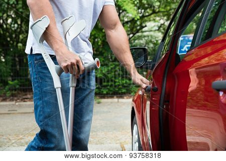 Disabled Man Opening Door Of A Car