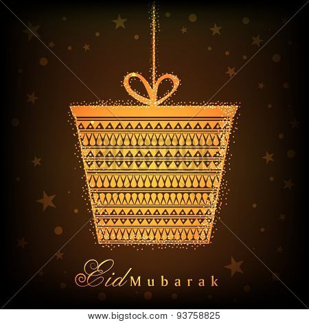 Beautiful golden hanging gift box on stars decorated brown background for Islamic holy festival, Eid celebrations.