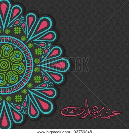Beautiful floral design decorated greeting card with Arabic Islamic calligraphy of text Eid Mubarak for famous festival of Muslim community, celebration.