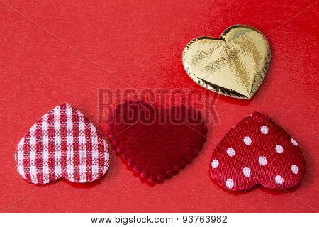 cloth hearts on red background