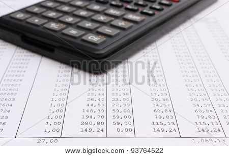 Closeup Of Spreadsheet With Calculator