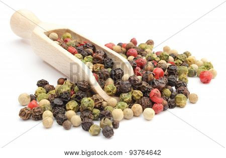 Colored Pepper On A Wooden Spoon Isolated On White Background
