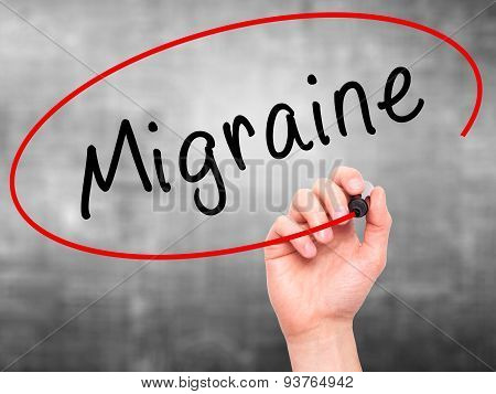 Man Hand writing Migraine with black marker on visual screen.