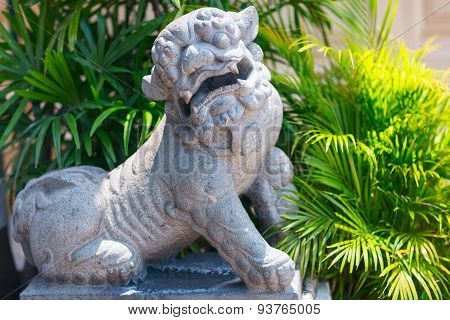 Stone lion statue. Wat Pho Temple in Bangkok.
