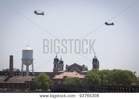 JERSEY CITY, NJ - MAY 26 2015: US Marine Corps helicopters fly above Ellis Island on the Upper New York Bay before the USS San Antonio departs Pier 92 at the end of Fleet Week NY 2015.
