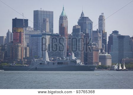 JERSEY CITY, NJ - MAY 26 2015: USS San Antonio (LPD 17) passes Lower Manhattan on the Upper New York Bay after departing Pier 92 at the end of Fleet Week NY 2015.