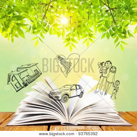 Open book with drawings on nature background