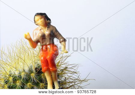 Woman Sitting On Cactus