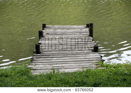 Peaceful Lake With Weathered Rustic Vintage Jetty