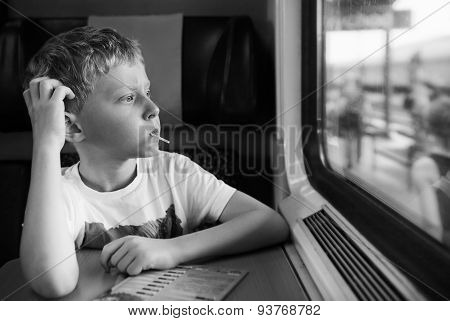 Bored Boy With Candy Look In Train Window
