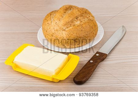 Butter, Bread In Plate And Knife On Table
