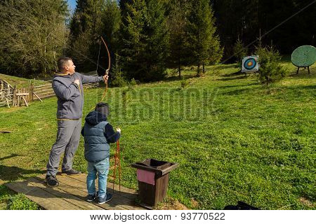 Father and son engaged in archery