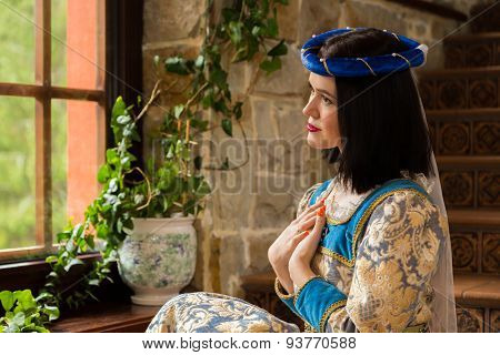 The girl in a medieval castle. Antique interiors.
