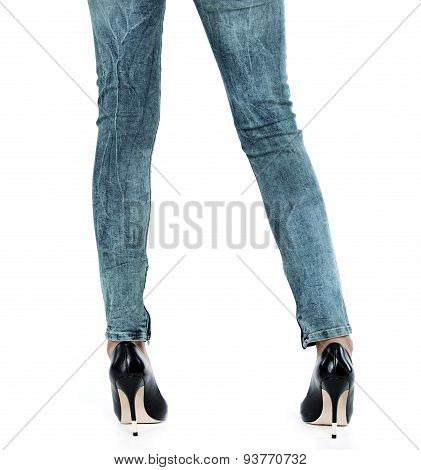 Female Legs In Jeans And Heels