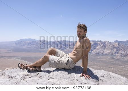 Relaxing On Mountain Peak In Desert
