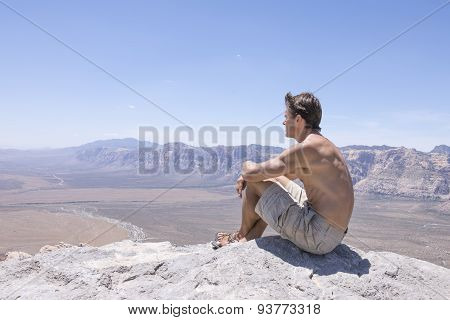 Resting At Top Of Summit In Desert