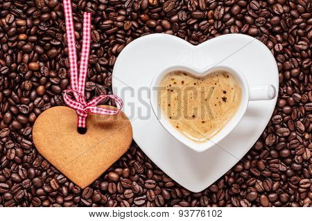 Heart Shaped Cup And Cookie On Coffee Beans Background