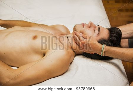 Young Man Getting Head and Face Massage